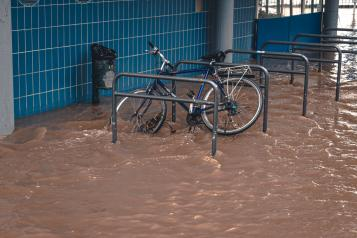 A chained up bike in flood water