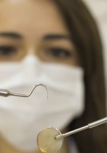 Dentist looking at equipment